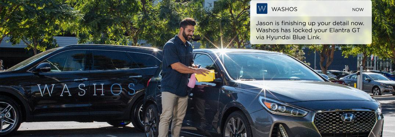 Washos employee cleaning Hyundai vehicle