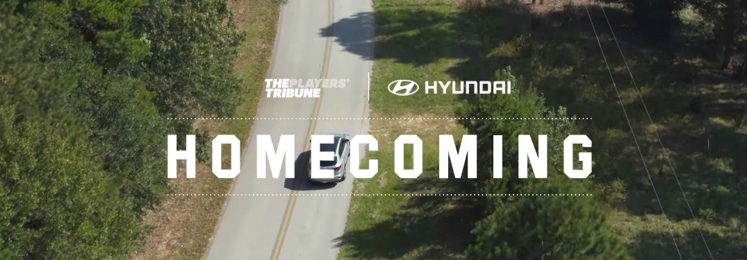 overhead view of Hyundai vehicle driving with Homecoming text