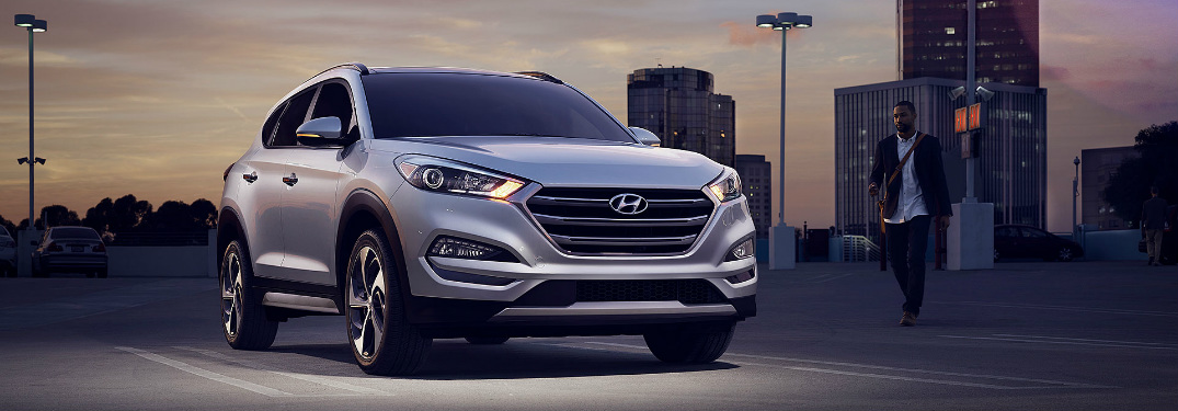 Man walking towards a 2018 Hyundai Tucson at night