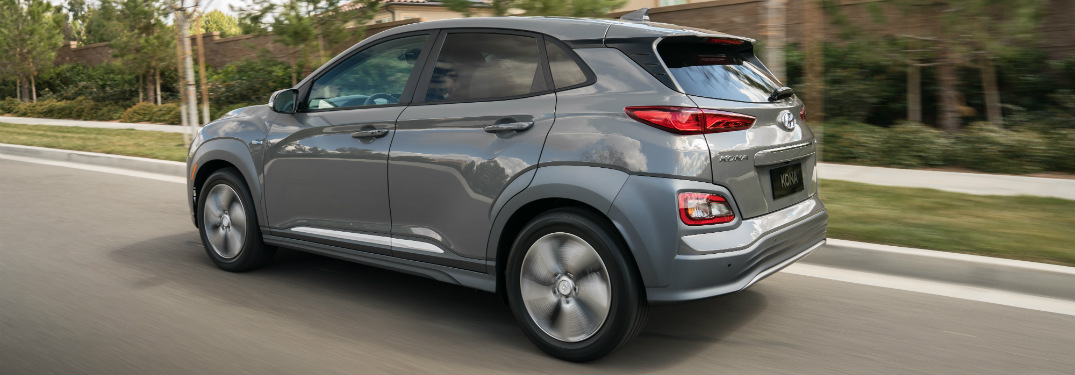 Grey 2019 Hyundai Kona Electric driving on open road