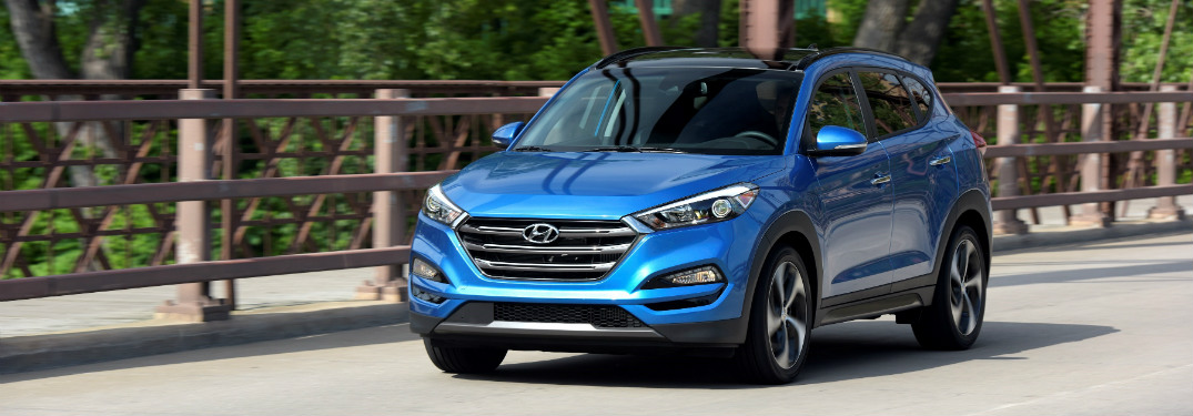 Blue 2018 Hyundai Tucson Sport driving on bridge