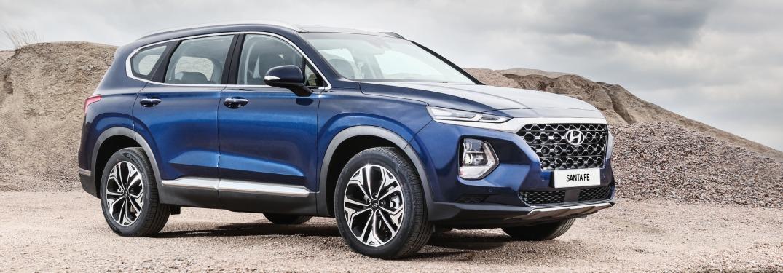 Side view of a blue 2019 Hyundai Santa Fe