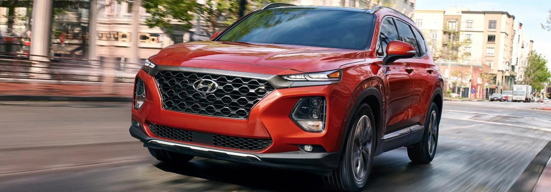 Front view of a red 2019 Hyundai Santa Fe