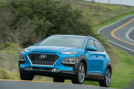 Blue 2019 Hyundai Kona driving on windy road
