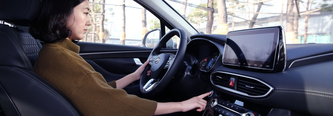 Woman using Hyundai smart fingerprint technology