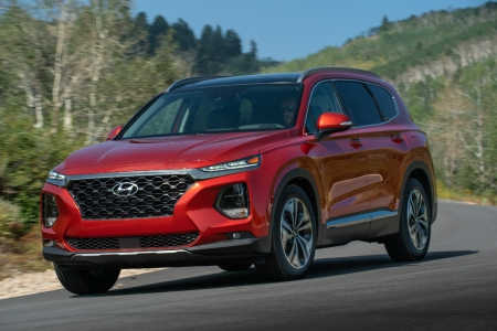 Red 2019 Hyundai Santa Fe driving on open road