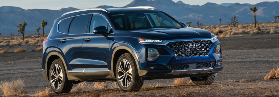 Side view of a blue 2019 Hyundai Santa Fe