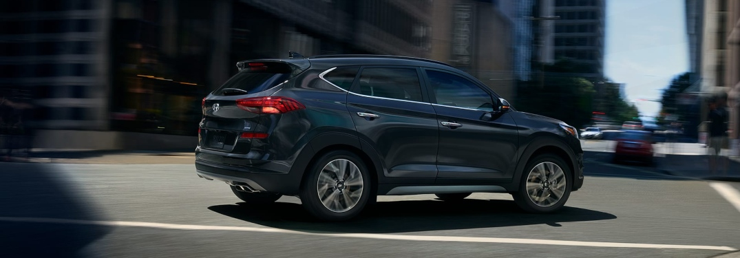 Side view of a 2019 Hyundai Tucson driving in city