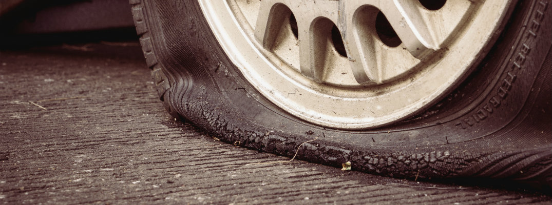 How to change a flat tire in a Chrysler vehicle