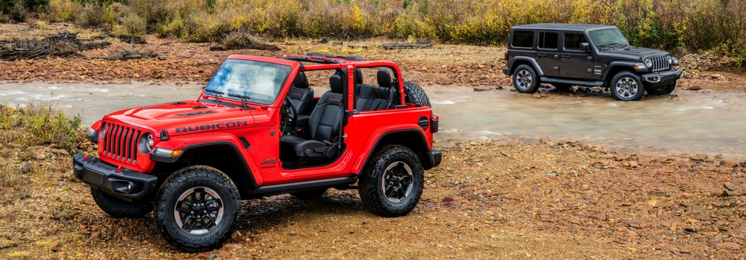 Two 2018 jeep wrangler vehicles in the desert