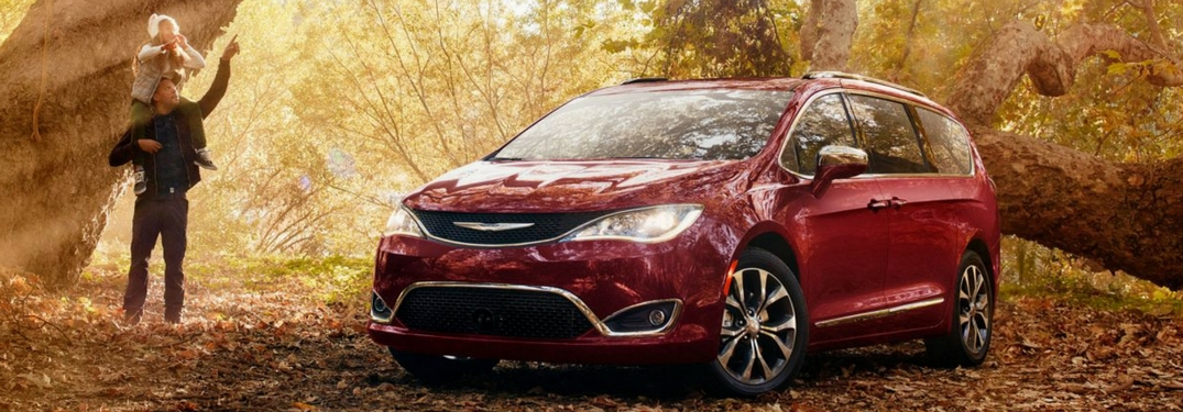 chrysler pacifica in the woods with father and daughter