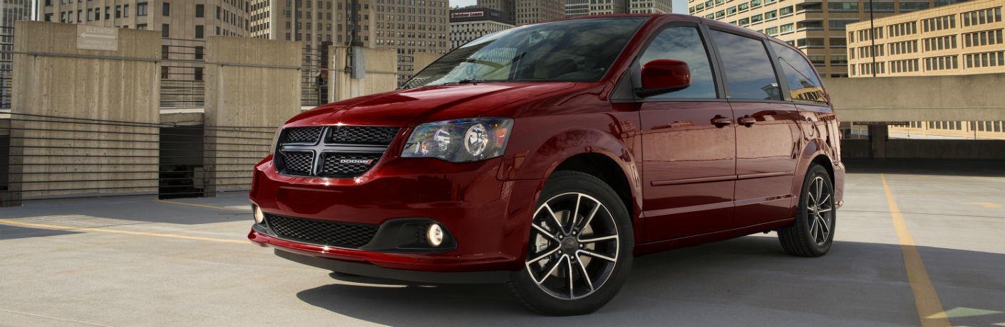 Red 2018 Dodge Grand Caravan parked in a parking lot