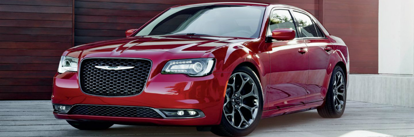 Red 2018 Chrysler 300 parked in a driveway