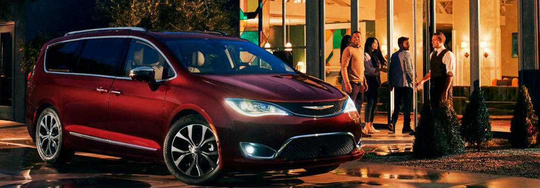 2018 Chrysler Pacifica Hybrid parked outside a house at night