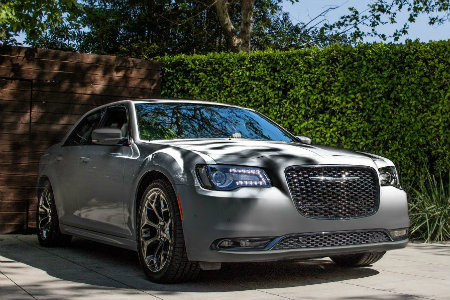 2018 Chrysler 300 parked by a hedge wall