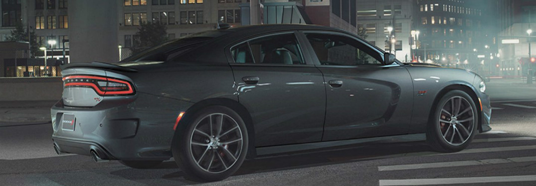2018 Dodge Charger driving down a city street at night.