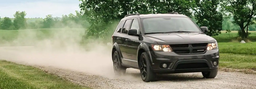 2018 Dodge Journey driving down a dirt road