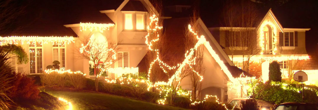 Row of houses decorated in Christmas lights