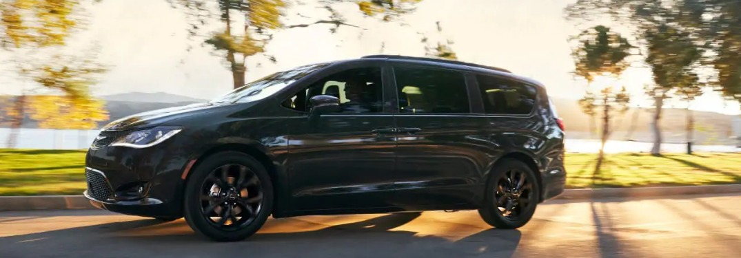 2019 Chrysler Pacifica driving down a sunny road