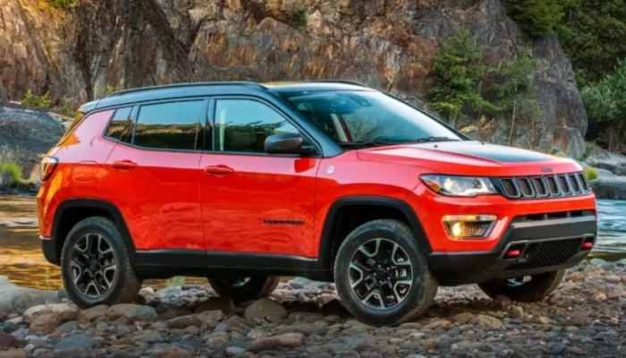 2019 Jeep Compass parked on a rocky beach