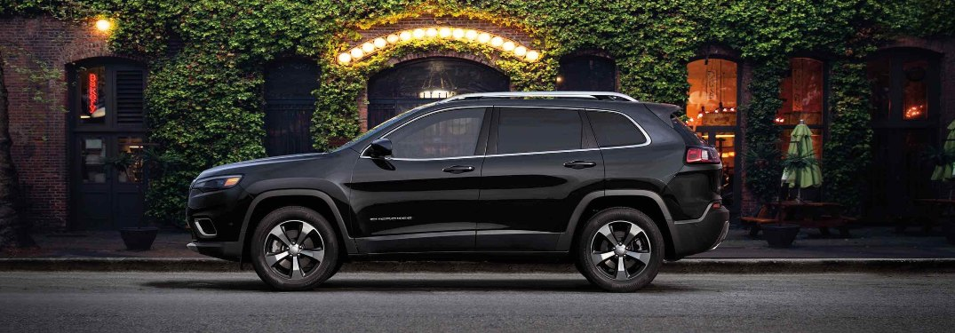 2019 Jeep Cherokee parked in front of a gate at night