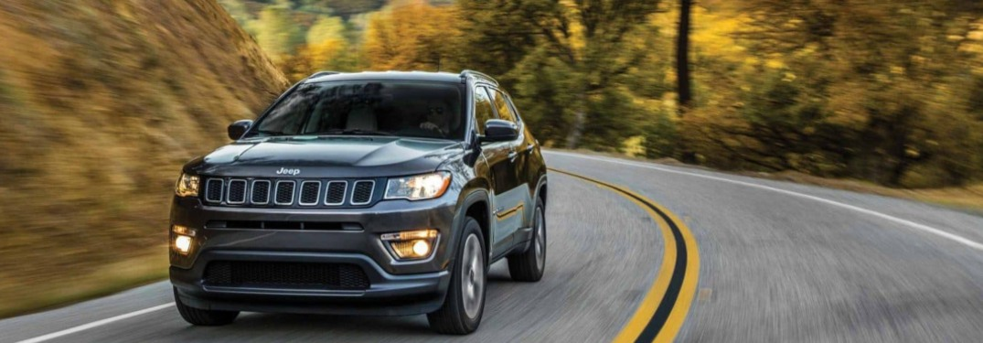 2019 Jeep Compass driving down a curving road