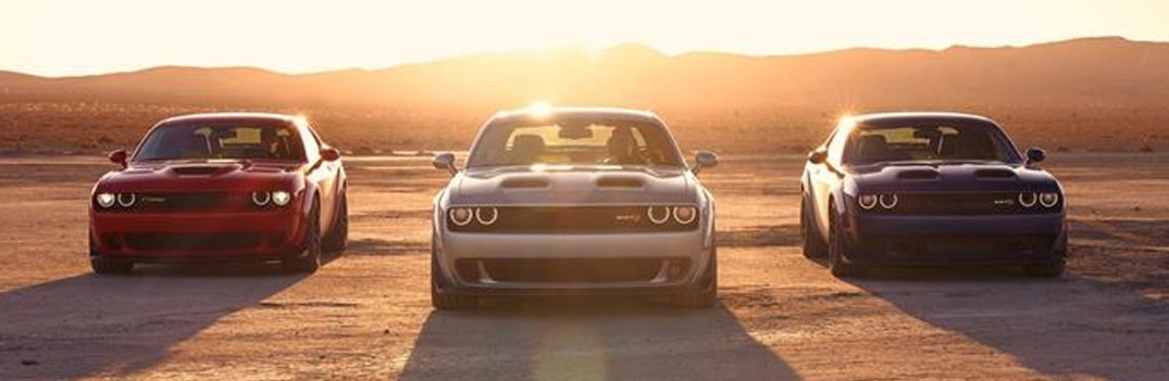 three 2019 Dodge Challenger cars parked in the desert