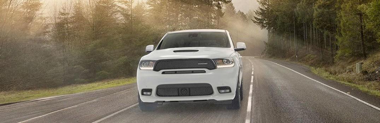 white 2020 Dodge Durango through forest
