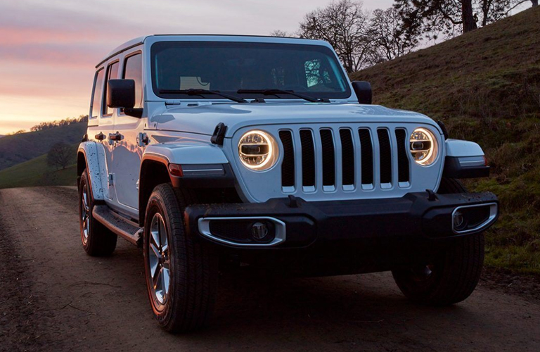 2020 Jeep Wrangler driving during dusk