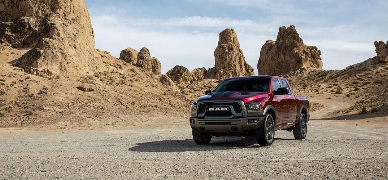 2019 Ram 1500 Classic red parked on gravel in desert mountain