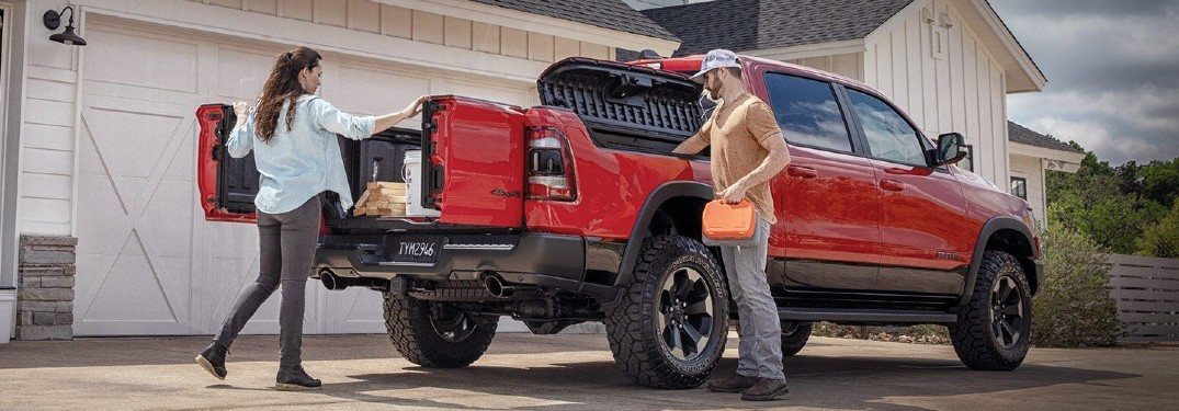 2020 Ram Multifunction Tailgate on Ram with red paint and couple getting supplies