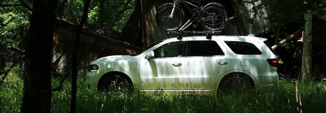 2020 Dodge Durango white profile view in dark green forest