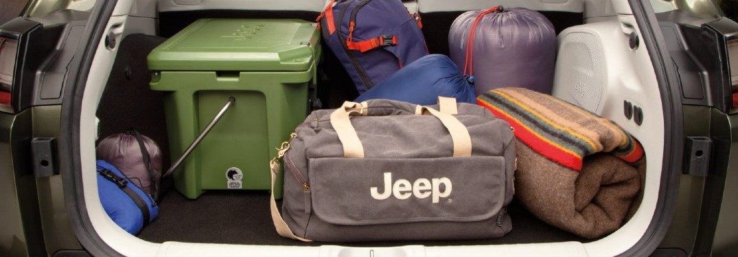 2020 Jeep Cherokee back end open loaded with totes and duffle bags