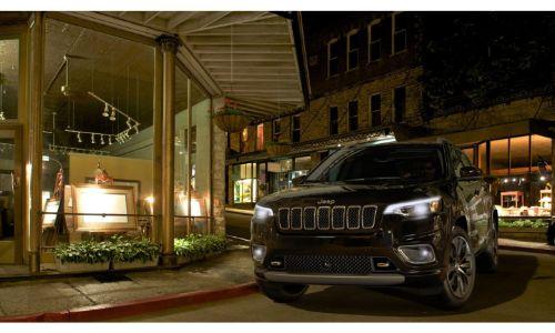 2020 Jeep Cherokee black headlights on at night dramatic angle