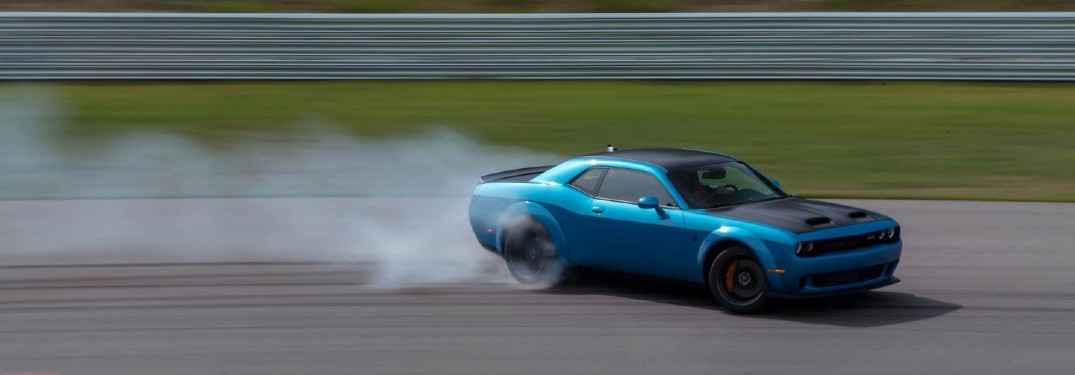 2020 Dodge Challenger blue smoke behind the tires motion blur