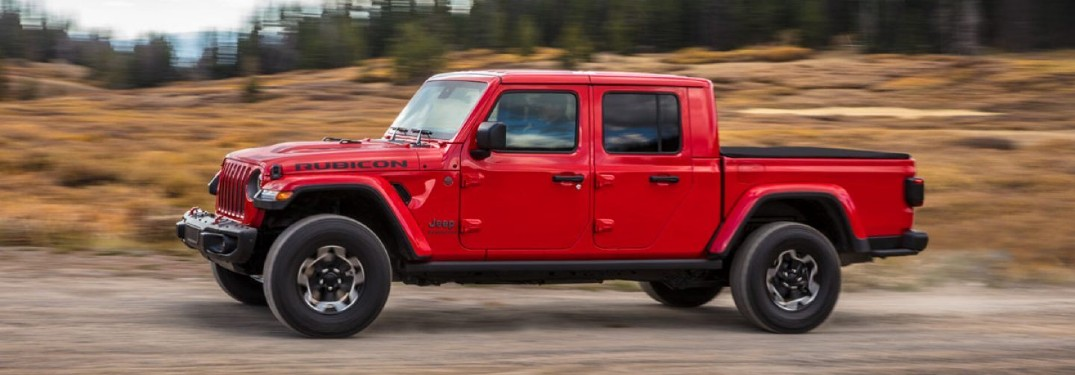 2020 Jeep Gladiator red paint driving to the right on desert road