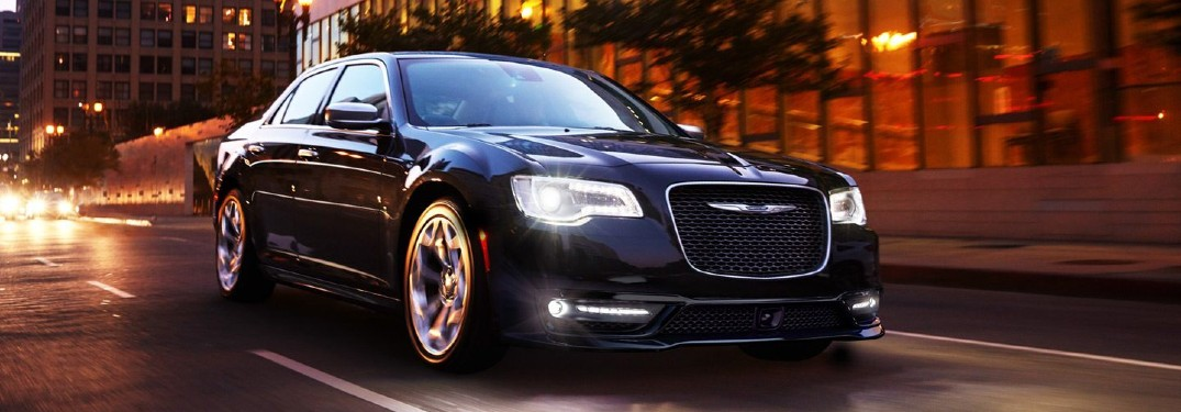 2020 Chrysler 300 black driving down the road in the evening