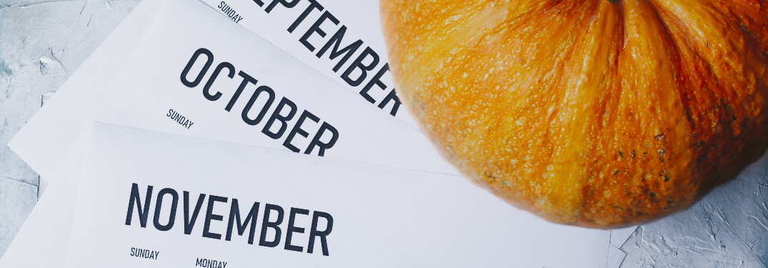 stock photo of calendar pages and pumpkin