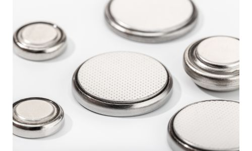 collection of small button batteries blank white background