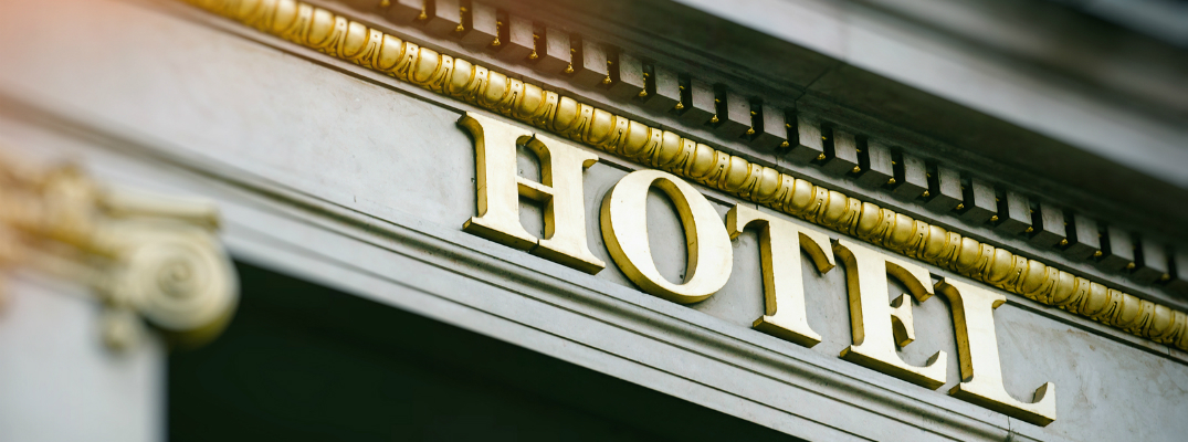 Hotel Sign on a Building with Sunlight Touching the Upper Corner