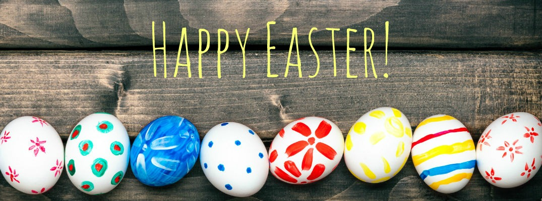 colored Easter eggs in a row on wooden boards with Happy Easter text overlaid
