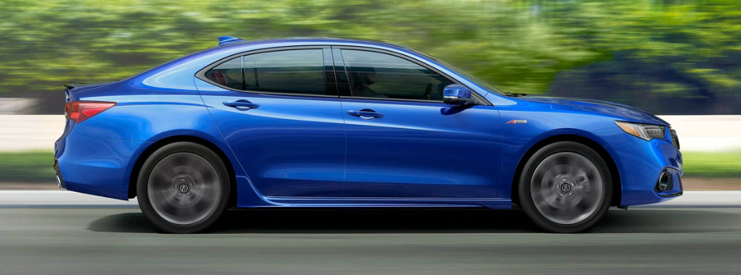 Profile view of blue 2018 Acura TLX driving on parkway in daytime