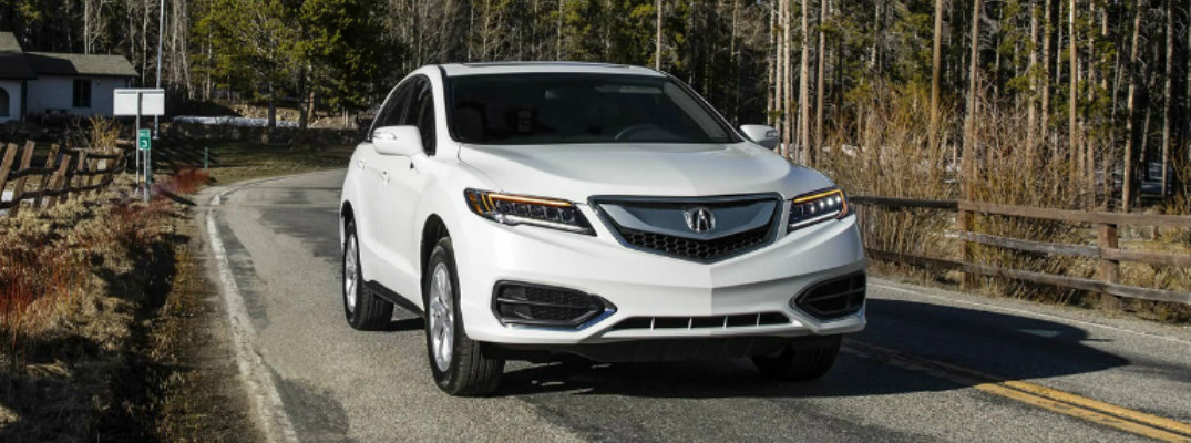 2018 Acura RDX driving on forested back road
