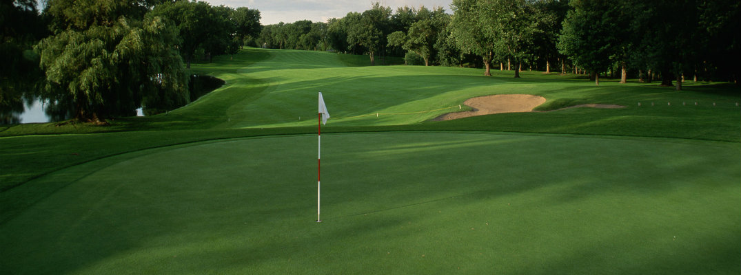 Shot of golf course focused on pin and hole