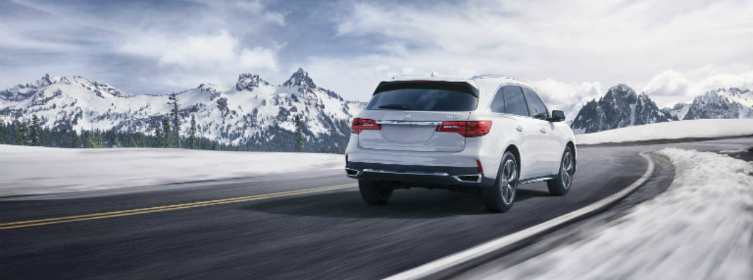 2018 Acura MDX driving on snowy road
