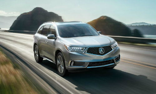 2018 Acura MDX driving on waterfront road in the morning