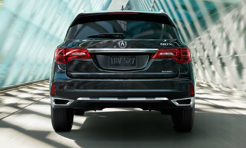 Rear shot of 2018 Acura MDX driving over bridge
