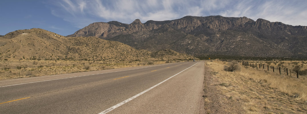 New Mexico road with monument in background