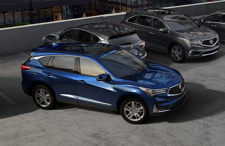 Blue 2019 Acura RDX pulling out of parking space