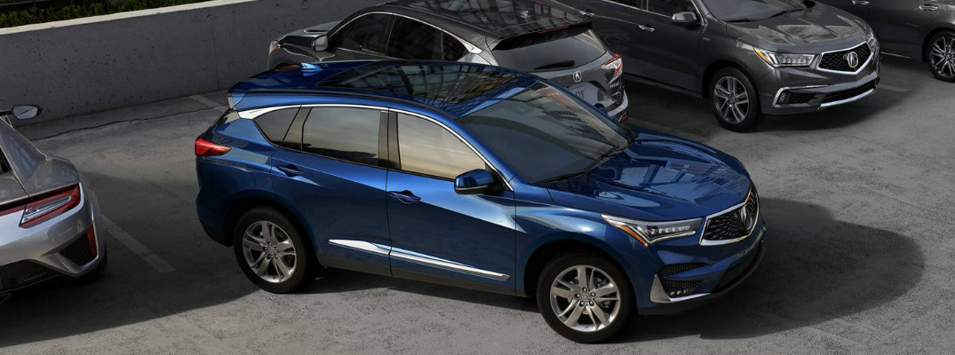 Blue 2019 Acura RDX driving out of parking space